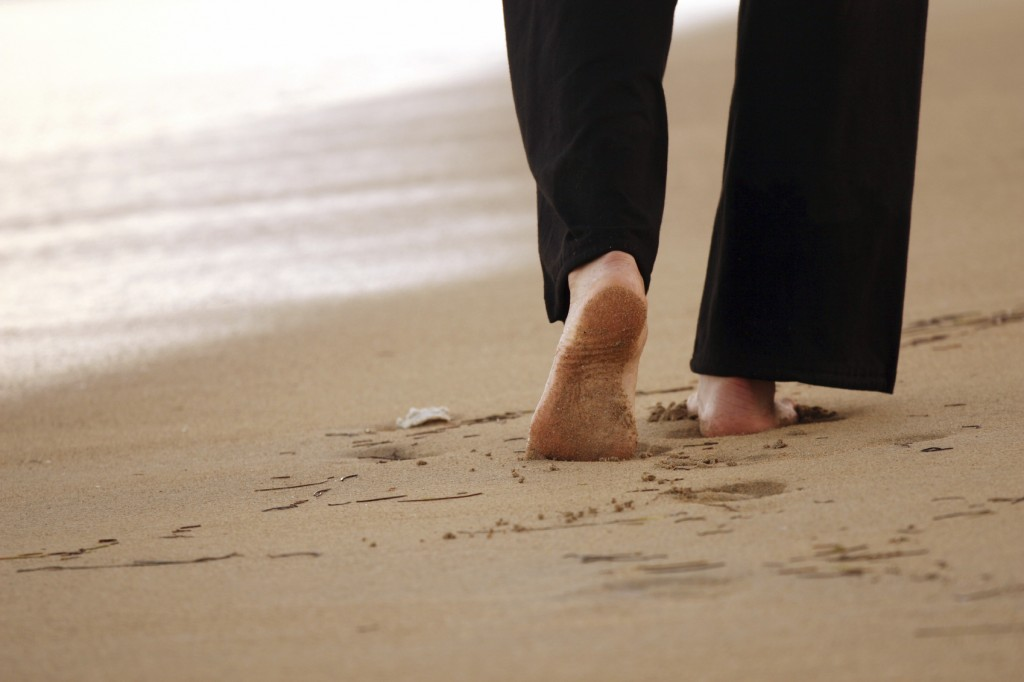 Woman walking on the sandbeach